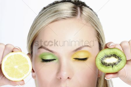 British ethnicity : Woman with halved kiwi fruit and a slice of lemon