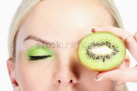British ethnicity : Woman with halved kiwi fruit