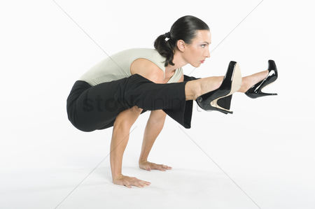 Ponytail : Woman with high heels exercising