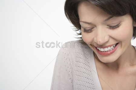 Head shot : Woman with large smile eyes closed close-up