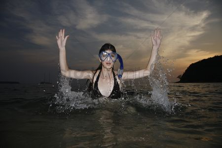Diving : Woman with scuba mask emerging from sea