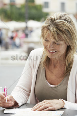 Women group outside : Woman writing postcards