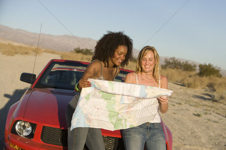 Car : Women looking at road map