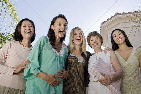 Women group outside : Women standing outside celebrating a baby shower