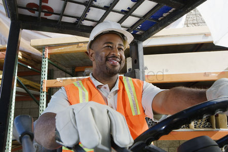 Head shot : Worker driving a forklift