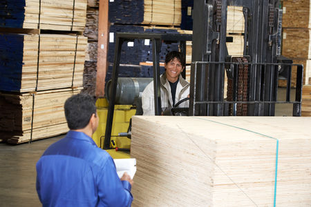 Forklift : Workers with forklift carrying wood in warehouse