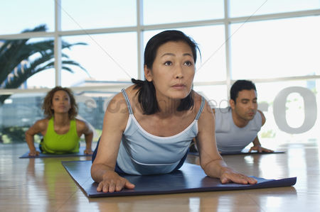 Women : Yoga class at health club
