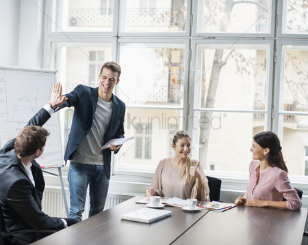 Three quarter length : Young business team enjoying success at conference table