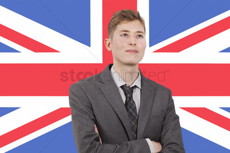 Respect : Young businessman with arms crossed over british flag