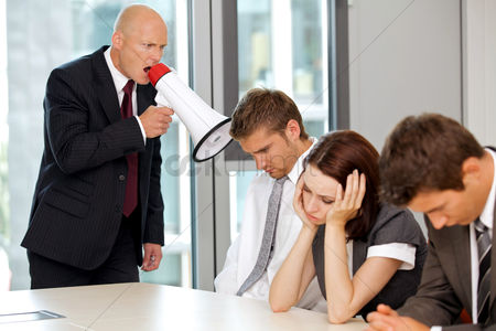 Young woman : Young confident caucasian businessman screaming on his employee
