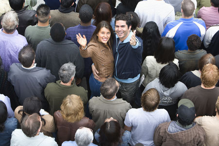 Women group outside : Young couple embracing among crowd