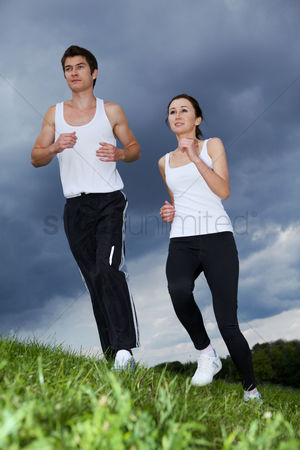 Workout : Young couple exercising in park