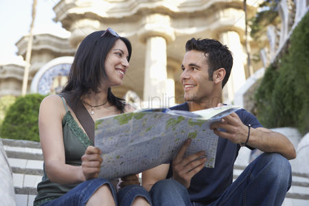 Steps : Young couple reading city map