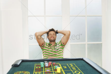 Loss : Young man losing on roulette table