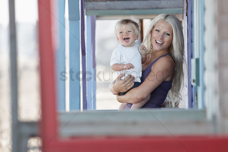 England : Young mother holding son  1-2  on outdoor porch portrait