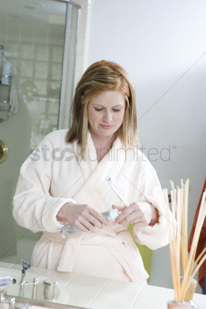 Tooth brush : Young woman brushing teeth