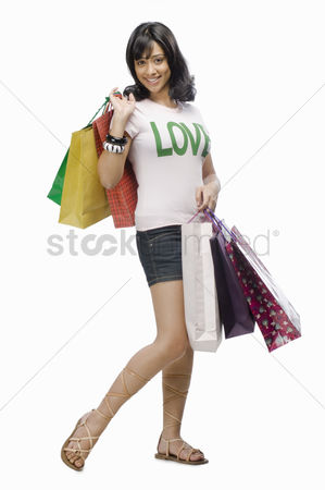 Spending money : Young woman carrying shopping bags