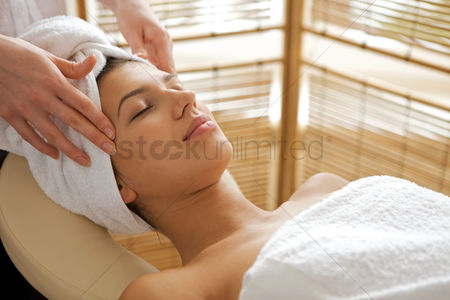 Spa : Young woman receiving energy therapy  eyes closed