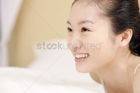 Lying forward : Young woman smiling