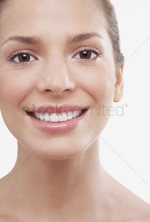 Satisfaction : Young woman smiling
