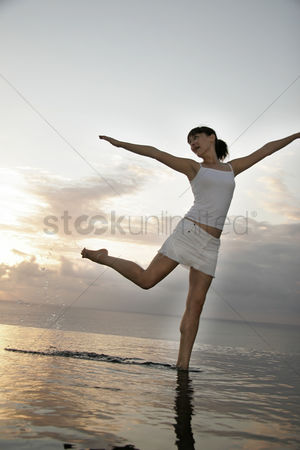 Dance : Young woman standing on water