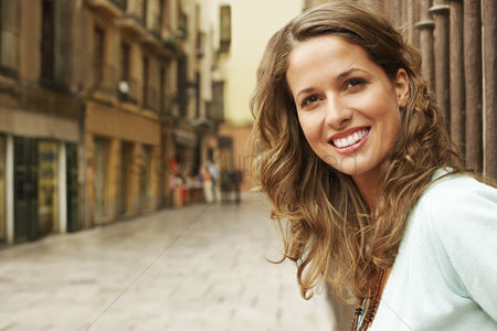 Leisure : Young woman standing outside buildings in street portrait