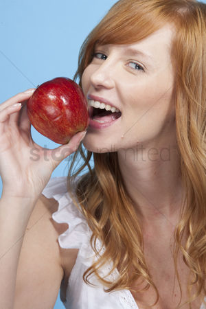 Try : Young woman with apple in studio